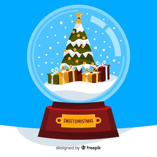 Secouer le globe avec un sapin et des cadeaux Vecteur gratuit