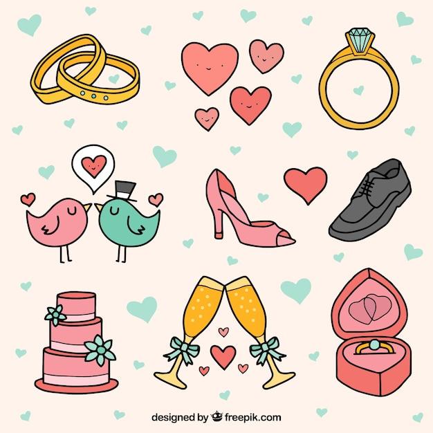 Sélection d'objets de mariage mignons en style dessiné à la main Vecteur gratuit