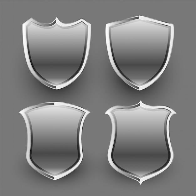 Set de 3 boucliers métalliques brillants et badges Vecteur gratuit
