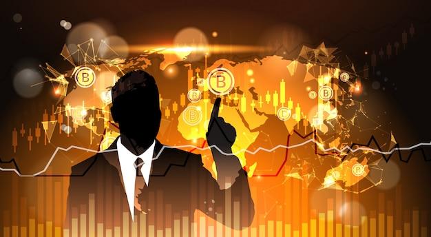 Silhouette homme d'affaires point doigt vers bitcoin sur la carte du monde crypto monnaie concept web numérique m Vecteur Premium