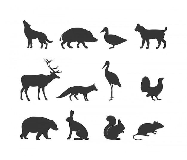 Silhouette noire d'animaux sauvages et symboles d'animaux sauvages Vecteur Premium