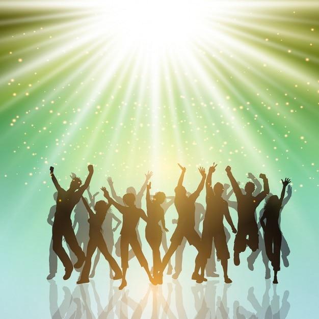 Silhouettes de gens du parti qui dansent sur un fond starburst Vecteur gratuit