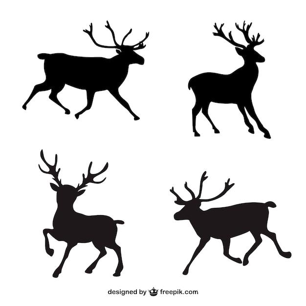Silhouettes noires de rennes Vecteur gratuit