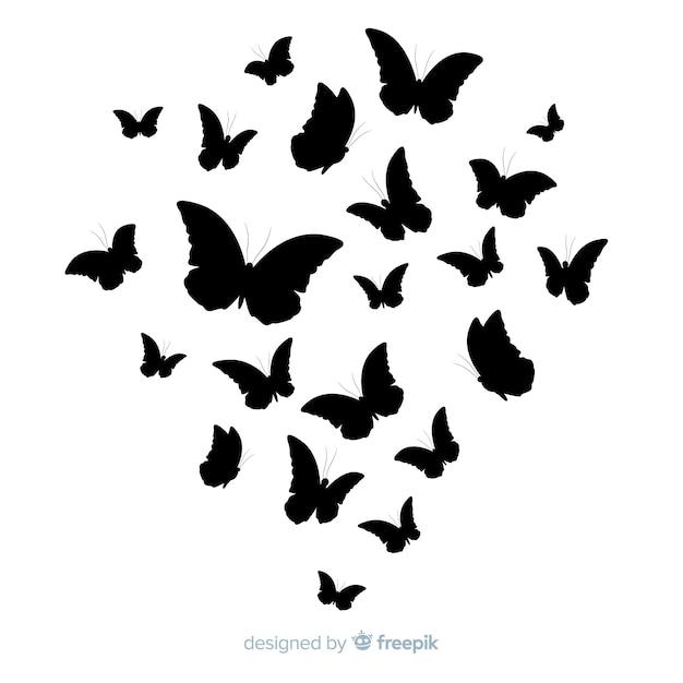 Silhouettes de papillon volant Vecteur gratuit