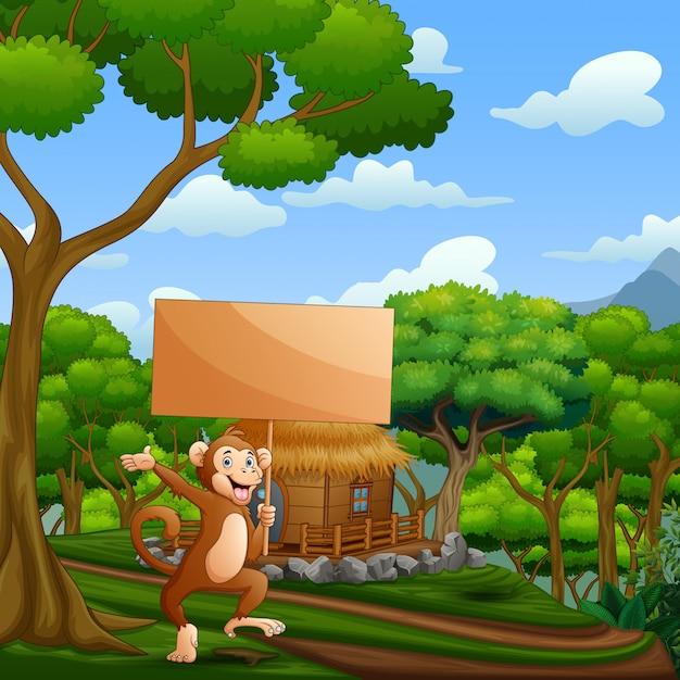 Singe De Dessin Animé Tenant Une Pancarte En Bois Dans La Nature Vecteur Premium