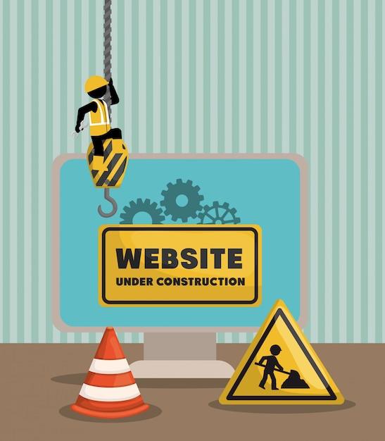 Site en construction avec ordinateur de bureau Vecteur Premium