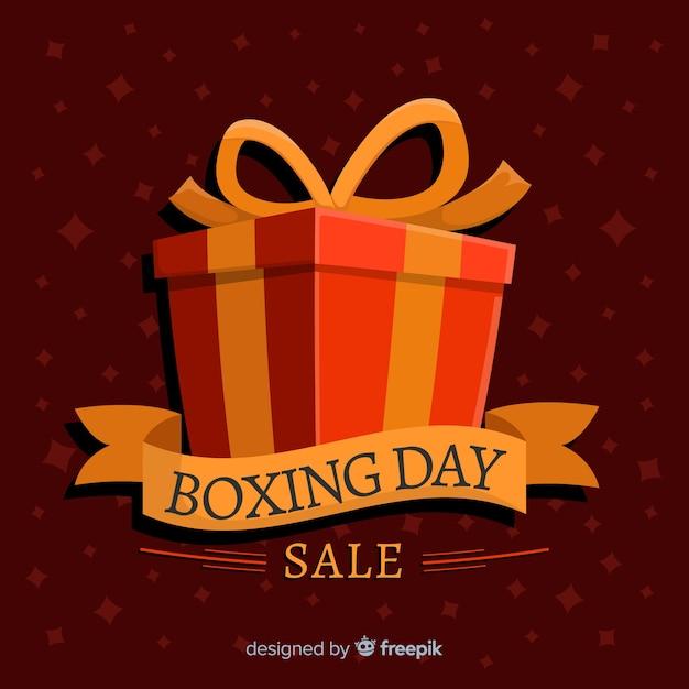 Solde de boxe plat avec boîte-cadeau emballée et ruban Vecteur gratuit