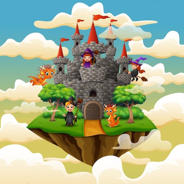 Sorcières et dragon volaient autour du château sur les nuages Vecteur Premium