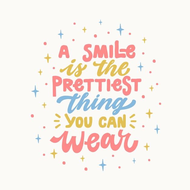 Un sourire est la plus jolie chose que vous puissiez porter une citation de lettrage inspirée et inspirée Vecteur Premium