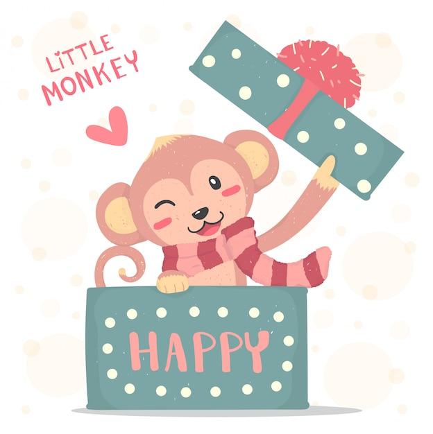 Sourire heureux petit singe avec foulard rouge apparaît dans une boîte cadeau, dessin animé mignon de vecteur plat Vecteur Premium