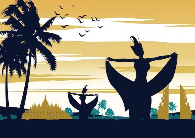 Spectacle de danse en indonésie au coucher du soleil, célèbre performance Vecteur Premium