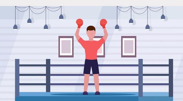 Sportif En Gants Rouges Mains Surélevées Boxeur Masculin Professionnel Célébrant La Lutte Réussie Victoire Concept Boxe Ring Arena Intérieur Horizontal Pleine Longueur Vecteur Premium