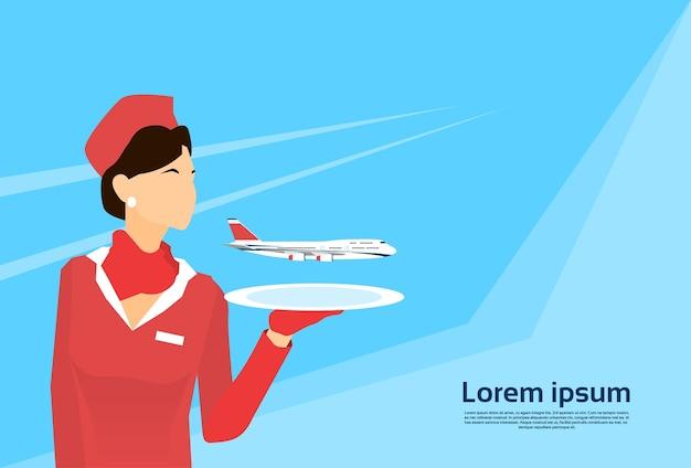 Stewardess hold tray avec plane copy space Vecteur Premium