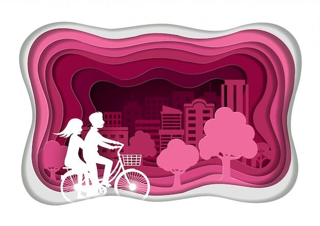Style d'art de papier. les amoureux des hommes et des femmes font du vélo. dans le parc public rose Vecteur Premium