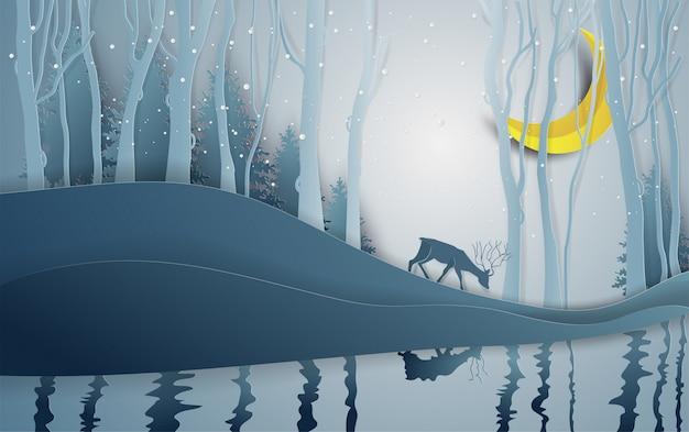 Style d'art de papier de la saison d'hiver et le cerf dans le paysage forestier avec fond de neige. Vecteur Premium