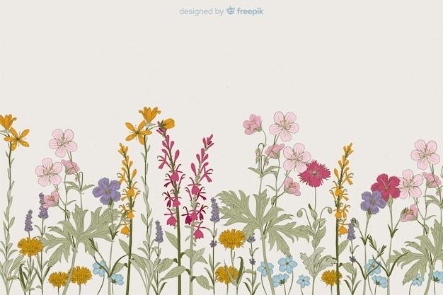 Style dessiné à la main fond floral Vecteur gratuit