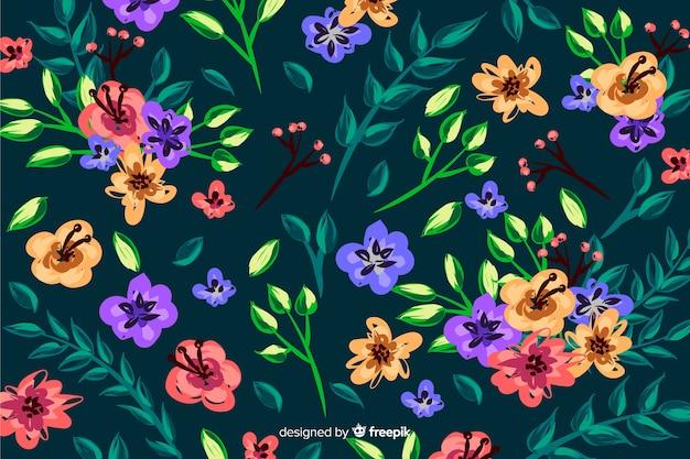 Style de fond de fleurs colorées peintes Vecteur gratuit