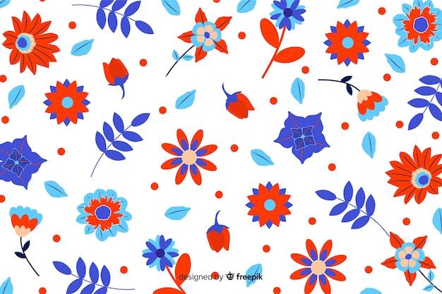 Style plat de fond de fleurs colorées Vecteur gratuit