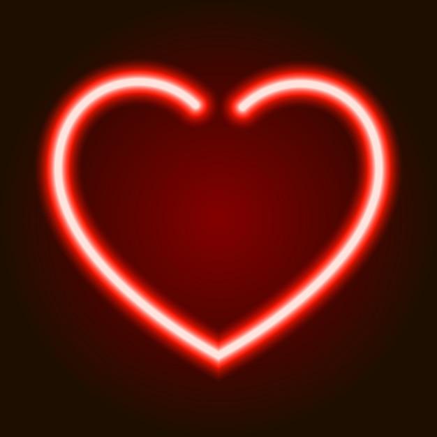 Symbole de cœur rougeoyant néon rouge de l'amour sur fond sombre de Vecteur Premium