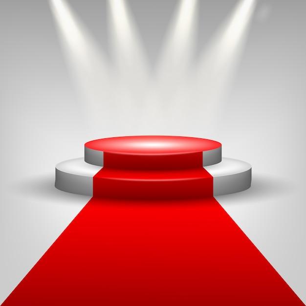 Tapis rouge à la scène du podium avec des projecteurs Vecteur Premium
