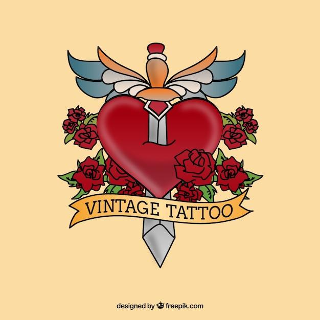 tatouage vintage avec un poignard sur le cœur Vecteur gratuit