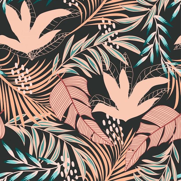 Tendance abstraite modèle sans couture avec des feuilles tropicales colorées Vecteur Premium