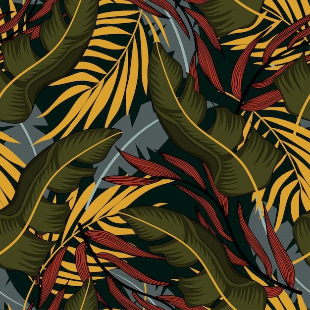 Tendance modèle sans couture abstraite avec des feuilles tropicales colorées et des plantes sur fond bleu Vecteur Premium