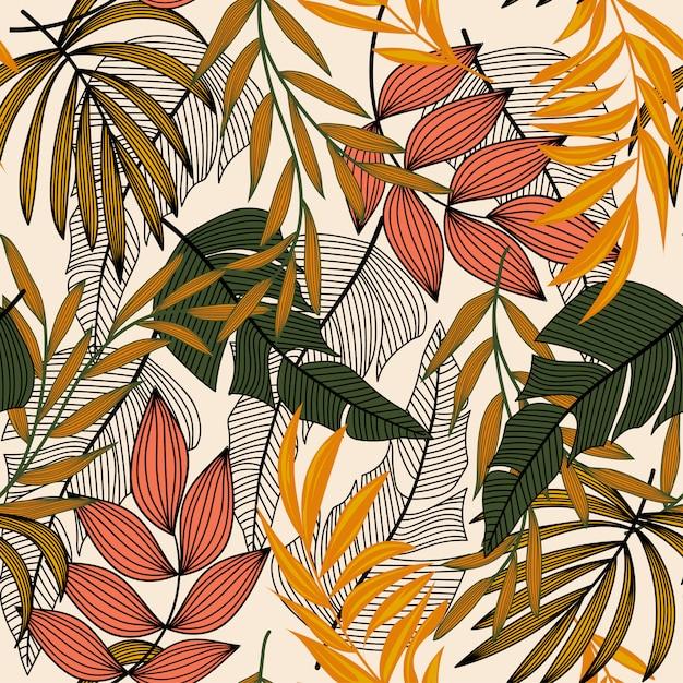 Tendance modèle sans couture abstraite avec des feuilles tropicales colorées et des plantes sur une lumière Vecteur Premium