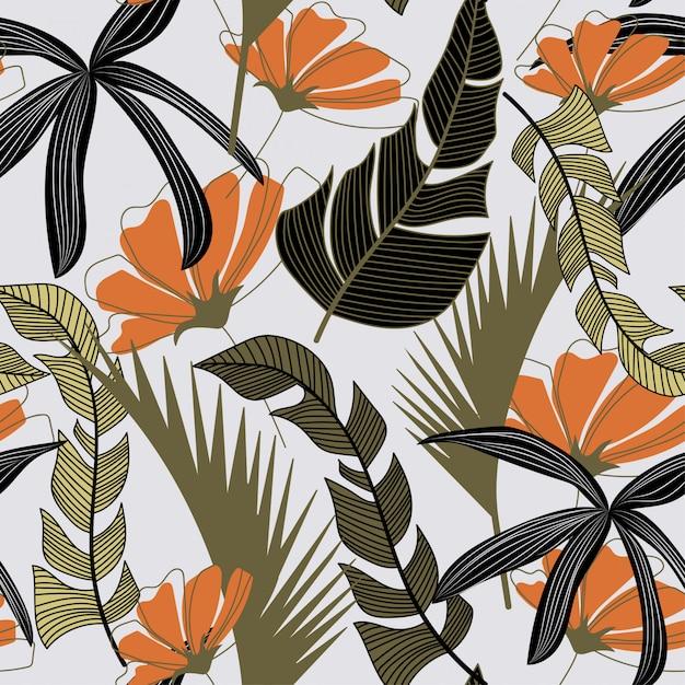 Tendance modèle sans couture avec des fleurs et des feuilles tropicales colorées Vecteur Premium