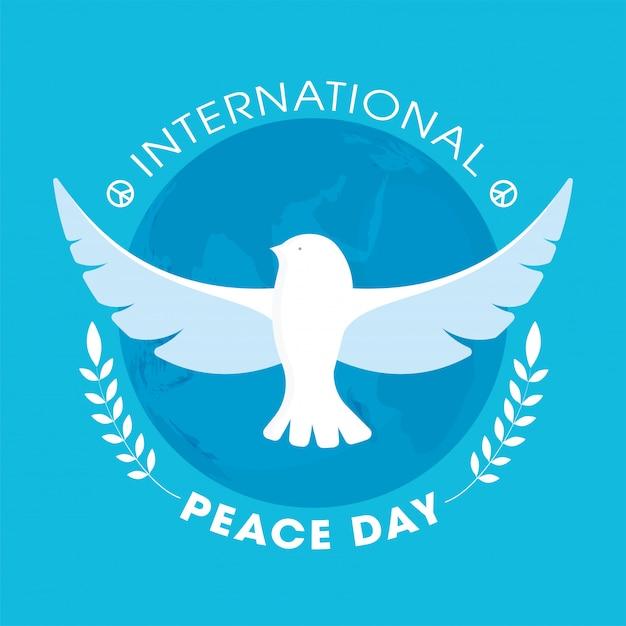 Texte De La Journée Internationale De La Paix Avec Colombe Volante Et Branches De Feuilles Sur Fond De Globe Terrestre Bleu. Vecteur Premium