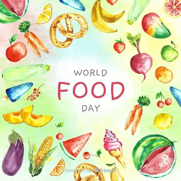Texte de la journée mondiale de l'alimentation entouré d'aliments Vecteur gratuit