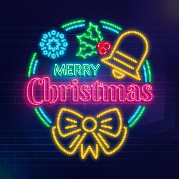 Texte De Joyeux Noël Au Néon Avec Des éléments Vecteur gratuit