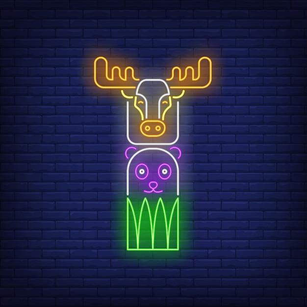 Totem avec signe néon et wapiti Vecteur gratuit