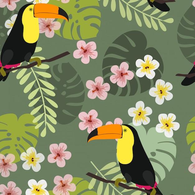 Toucan à feuilles et fleurs tropicales. Vecteur Premium