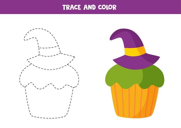 Tracez Et Coloriez Un Joli Petit Gâteau D'halloween Décoré D'un Chapeau De Sorcier. Coloriage éducatif. Vecteur Premium