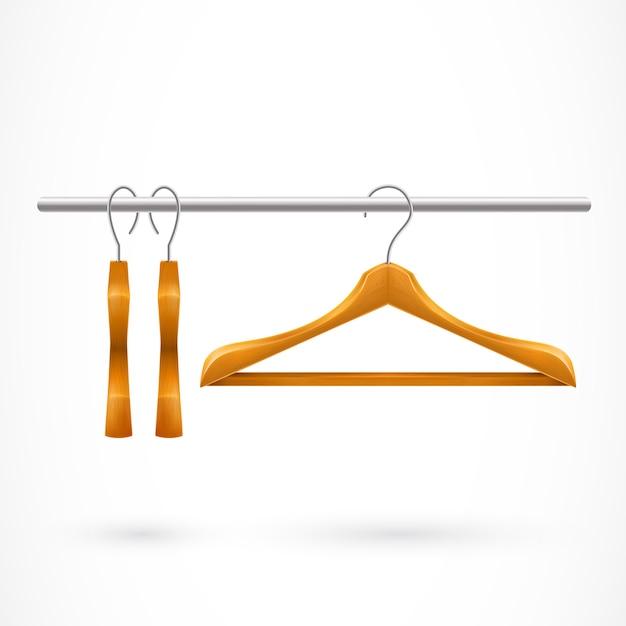 Trois cintres sur le rail de vêtements Vecteur gratuit