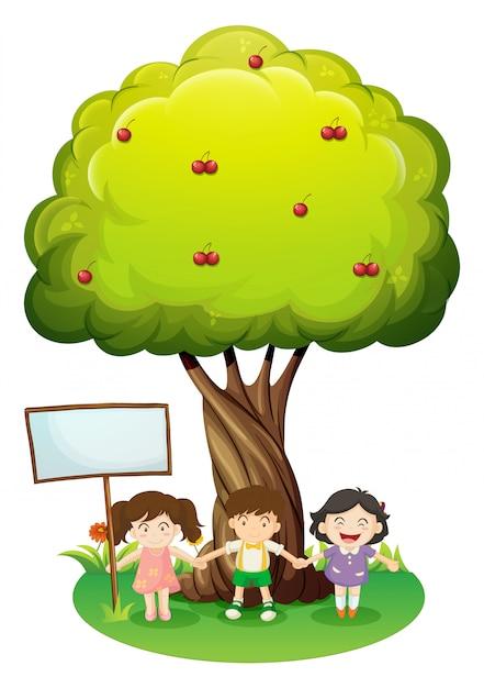 Trois enfants debout sous l'arbre avec un panneau vide Vecteur gratuit