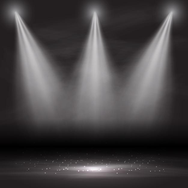 Trois projecteurs brillant dans une pièce vide Vecteur gratuit
