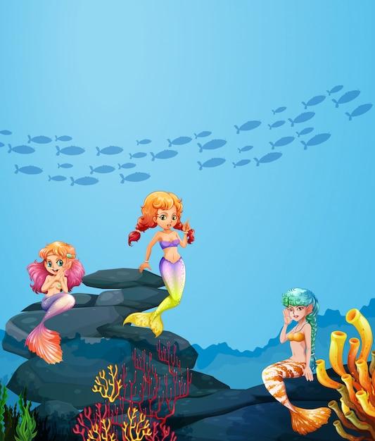 Trois sirènes nageant sous l'océan Vecteur Premium