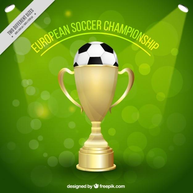 Trophée d'or avec une balle de football Vecteur gratuit