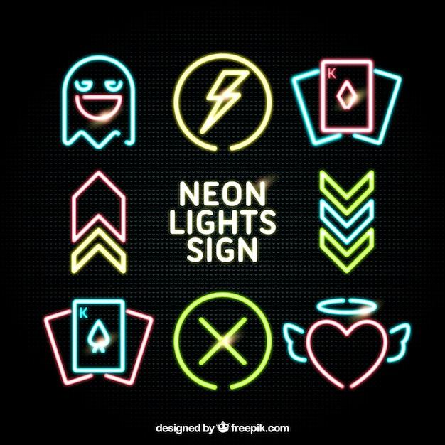 Un ensemble d'éléments d'éclairage au néon Vecteur gratuit