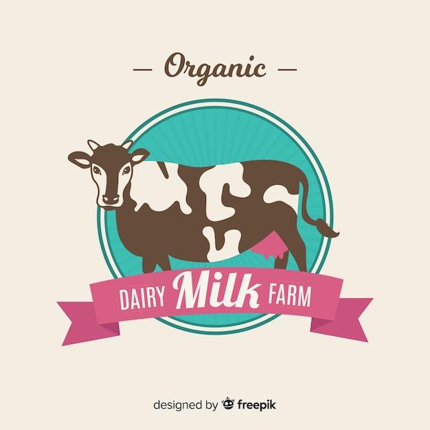 Vache plate avec logo de lait bio ruban Vecteur gratuit