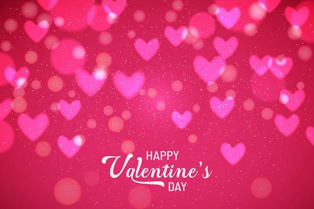 Valentine's background avec des coeurs brouillés Vecteur gratuit