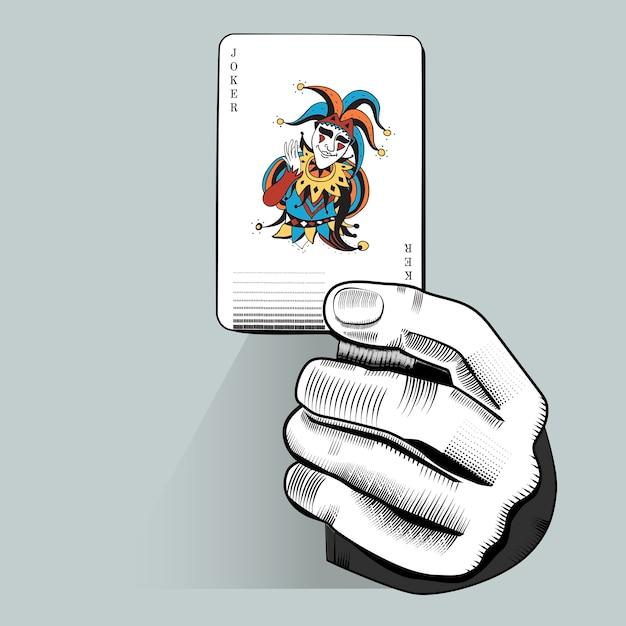 Vecteur de main tenant au hasard une carte à jouer Vecteur gratuit