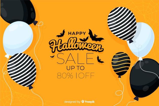 Vente de halloween design plat avec des ballons Vecteur gratuit