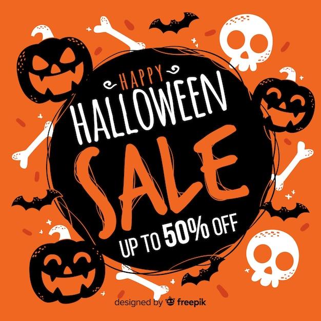 Vente d'halloween dessiné à la main avec citrouilles et crânes Vecteur gratuit
