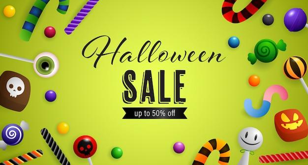 Vente d'halloween, jusqu'à cinquante pour cent d'écriture avec des bonbons Vecteur gratuit