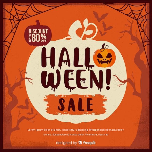 Vente d'halloween vintage avec des toiles d'araignées et de la citrouille Vecteur gratuit