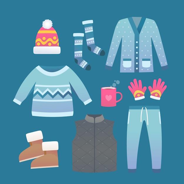 Vêtements d'hiver plats et l'essentiel avec une tasse de chocolat chaud Vecteur gratuit