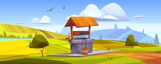 Vieux Puits En Pierre Avec De L'eau Potable Sur La Colline Verte Vecteur gratuit